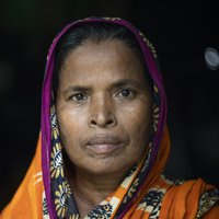 A portrait of Mossamat in a pink and orange sari