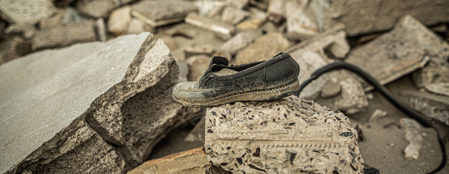 A single shoe sits on top of a pile of rubble in Arish Yemen