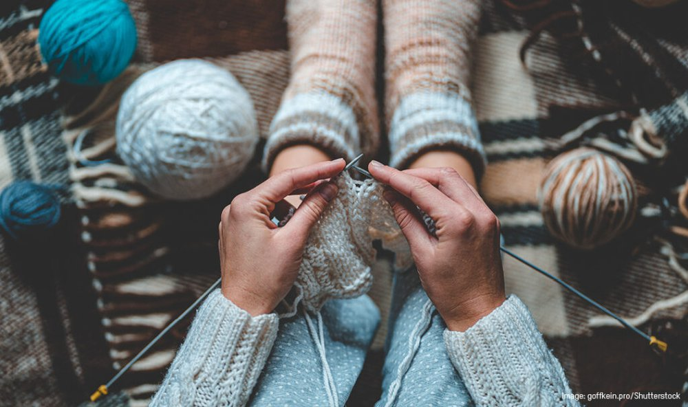A stock photo of a pair of hands knitting