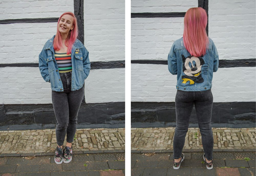 Zara Canfield wears second-hand jeans, a denim Mickey Mouse jacket and Nike trainers