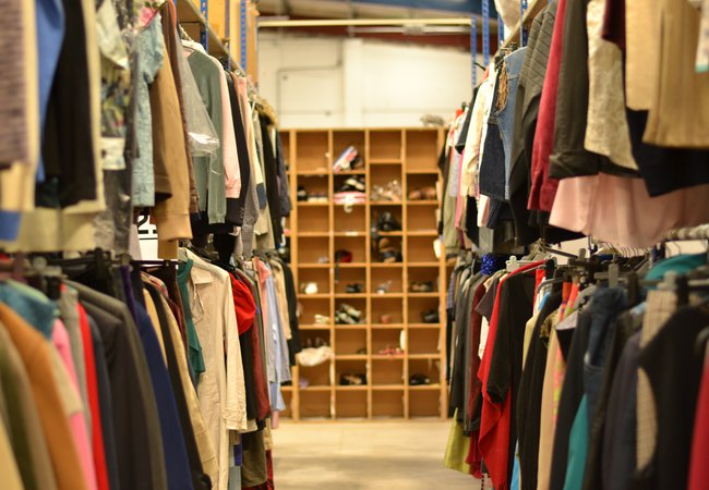 Racks of donated clothes at our Batley distribution hub