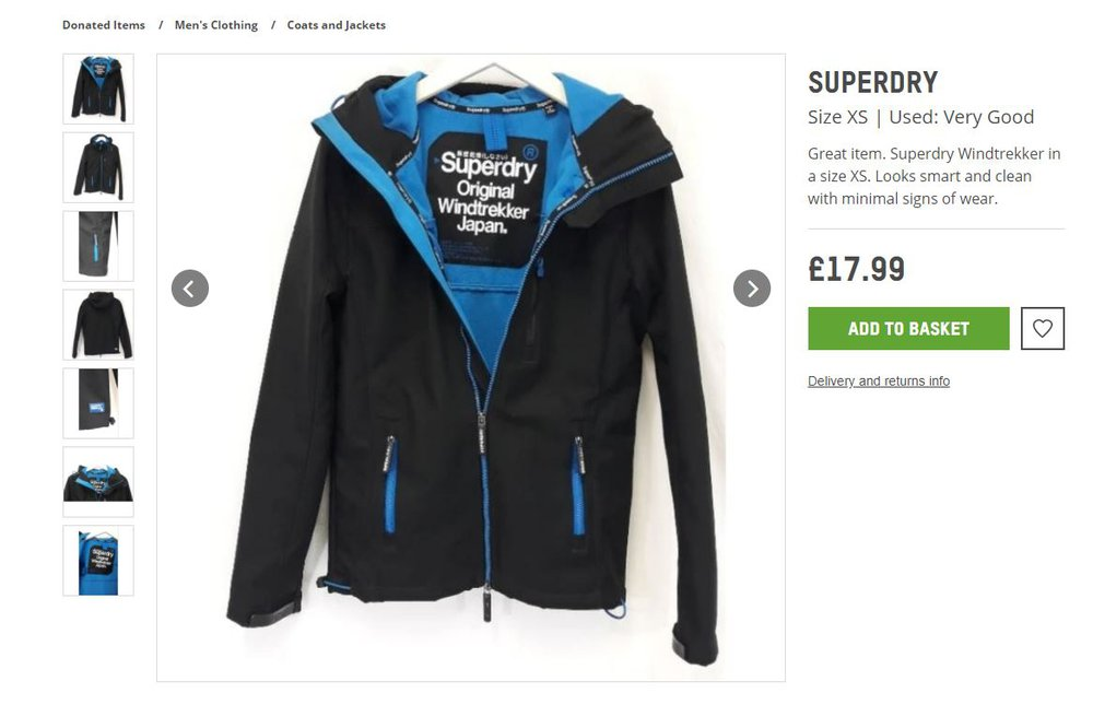 A black and blue waterproof jacket with a large Superdry label inside