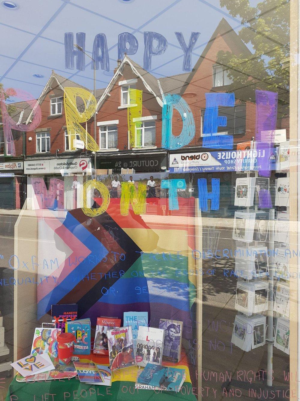An Oxfam Pride month shop window