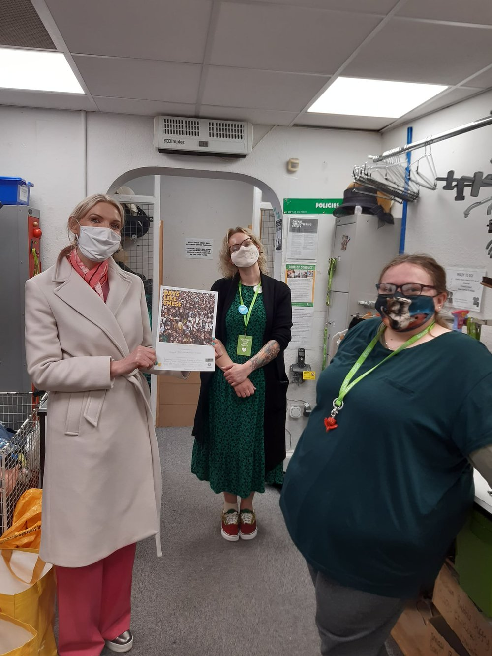 Staff wearing masks in the Oxfam Newport shop