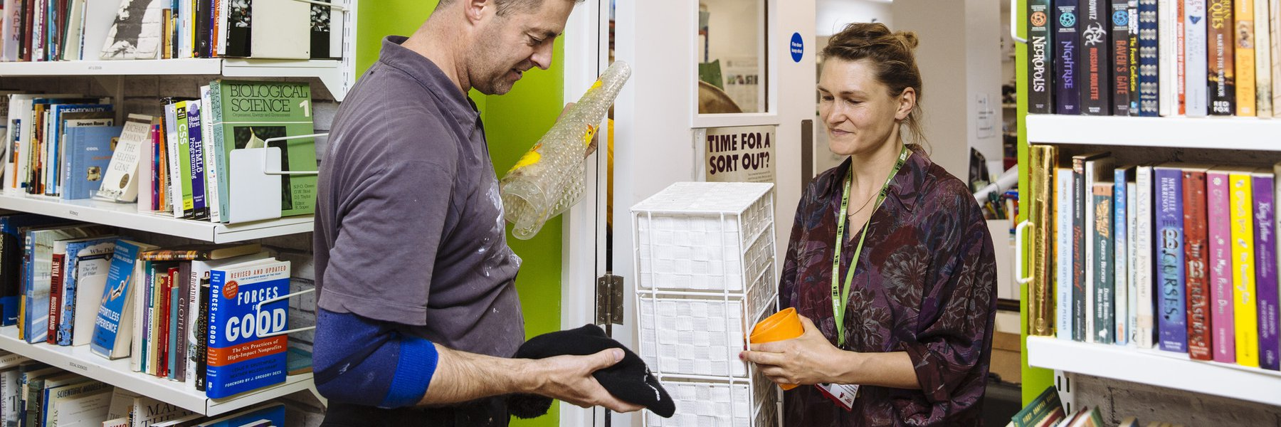 David Franklin, left, donates items to Angie Walter at the Oxfam shop on Cowley Road, Oxford