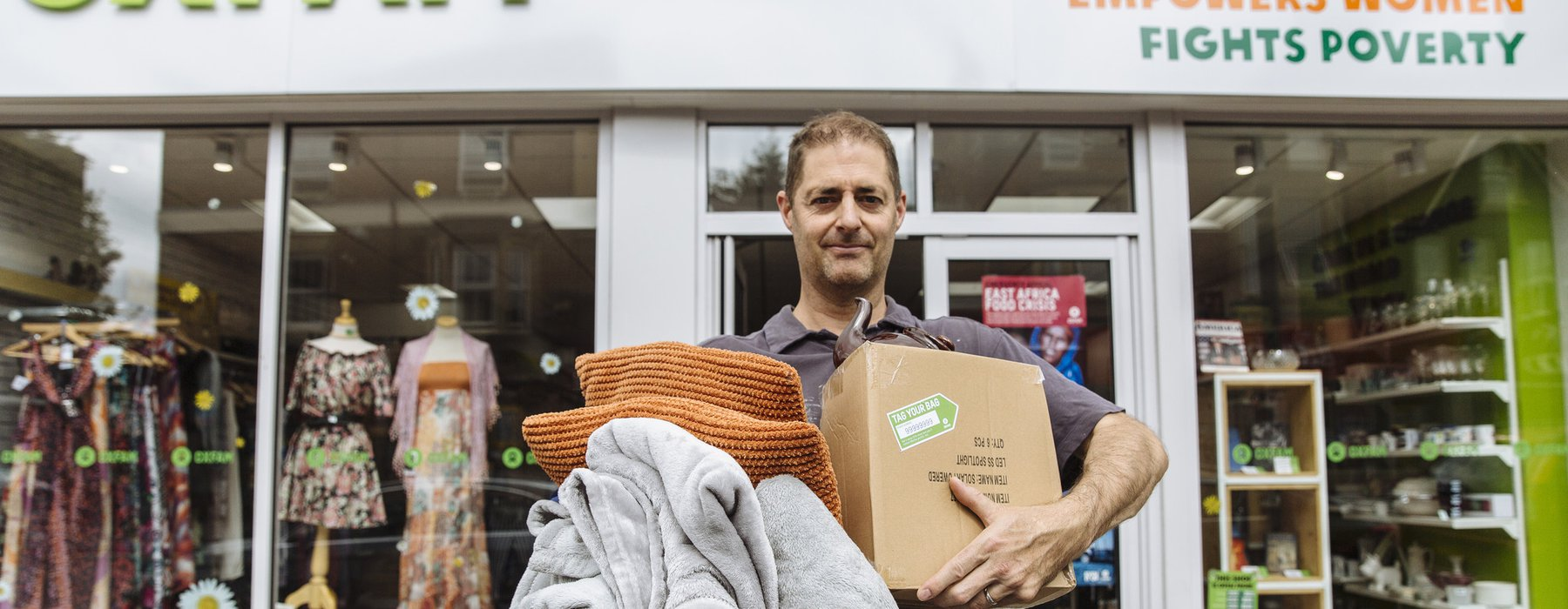 David Franklin poses with items to donate outside the Oxfam shop on Cowley Road, Oxford