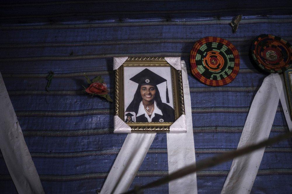 A portrait of Addise wearing a borrowed graduation robe