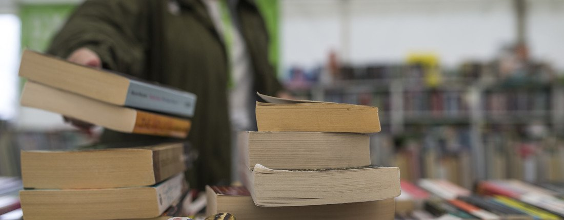 A pile of books in the Oxfam Bookshop at Hay Festival.