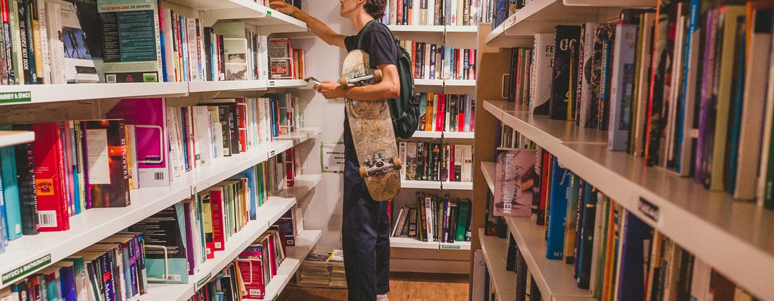 Lewis, 19, browses books in the Oxfam Books and Music Shop in Chorlton.