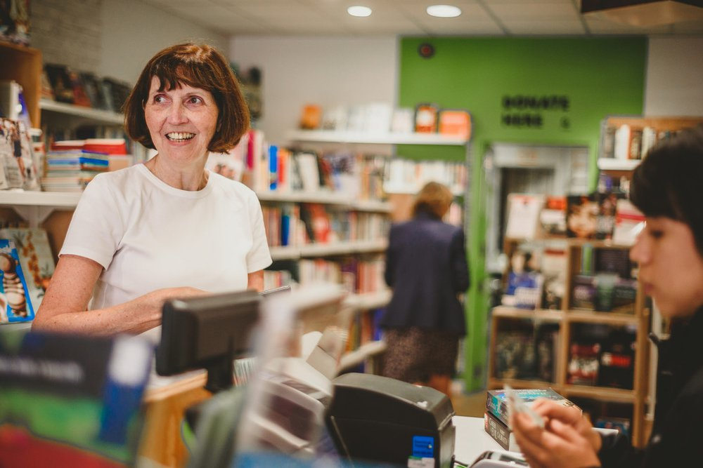 Lesley buying books in the Oxfam Books and Music Shop in Chorlton
