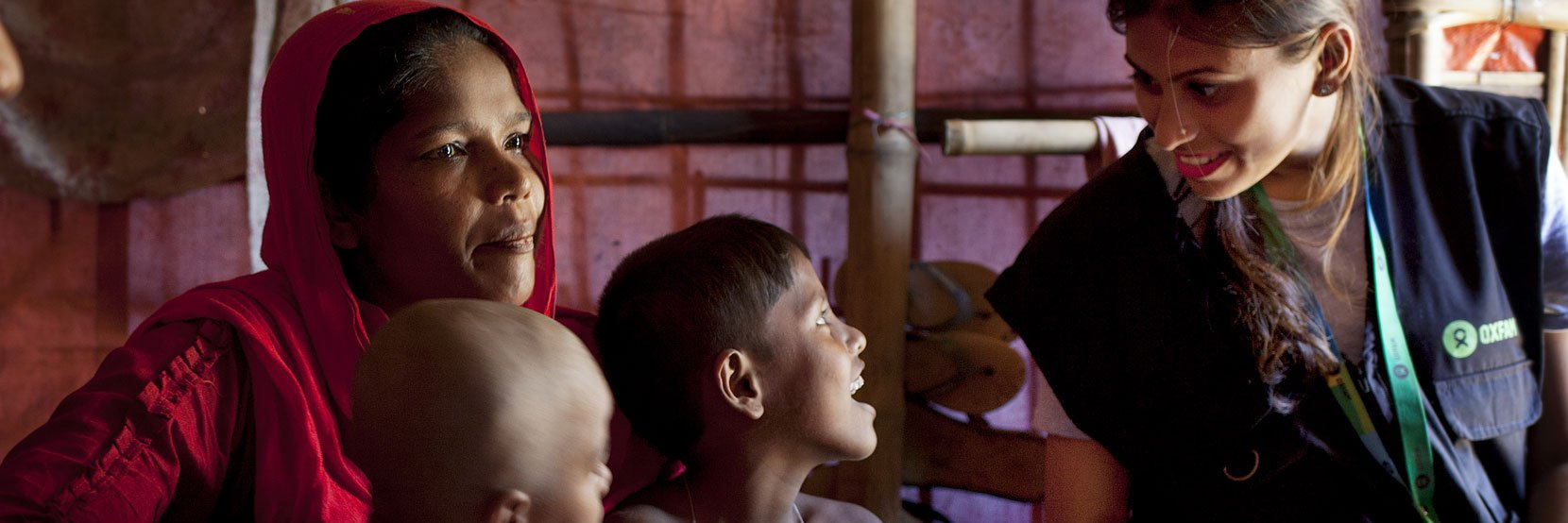 Iffat, humanitarian public health promoter for Oxfam, talks to Rohingya refugee in Cox's Bazar, Bangladesh.