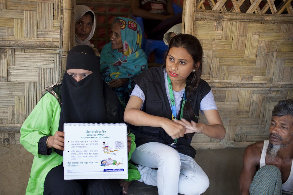 Iffat is a humanitarian public health promoter for Oxfam. In this photo she is training Rohingya refugees about good health and hygiene in Cox's Bazar, Bangladesh.