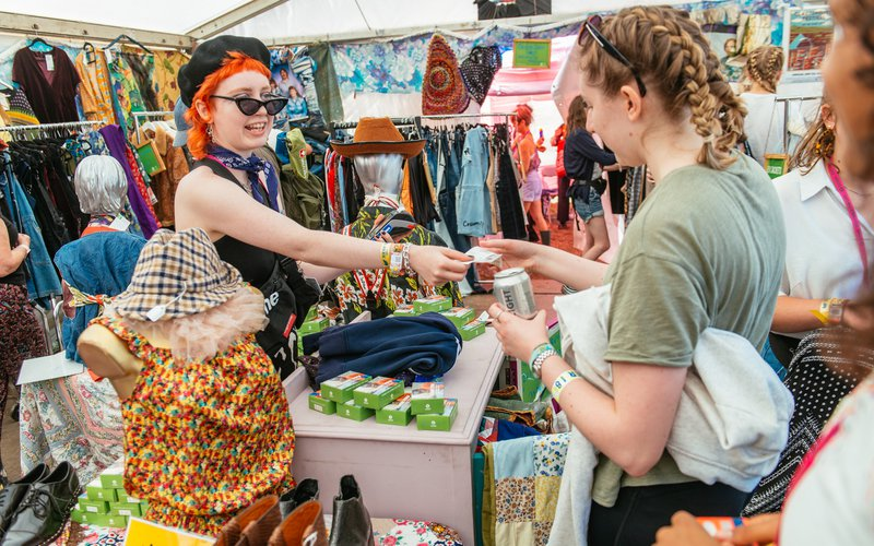 Clara working in Oxfam Shop at Glastonbury Festival 2019.