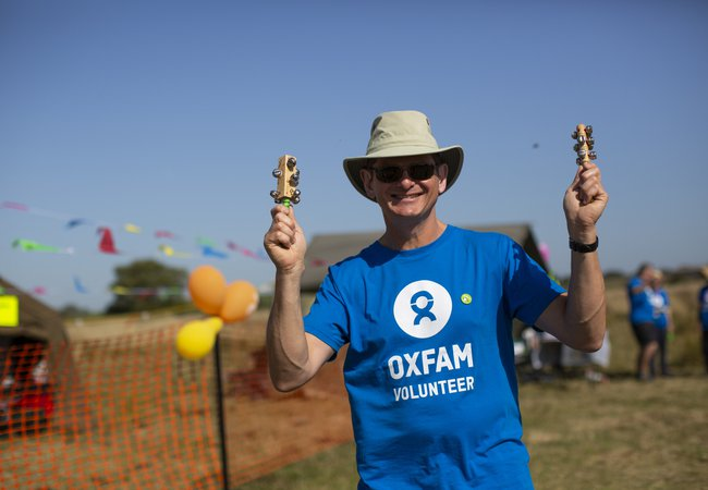 An Oxfam volunteer at Trailwalker 2019