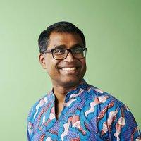 A portrait of Dhananjayan Sriskandarajah in a blue Hawaiian shirt
