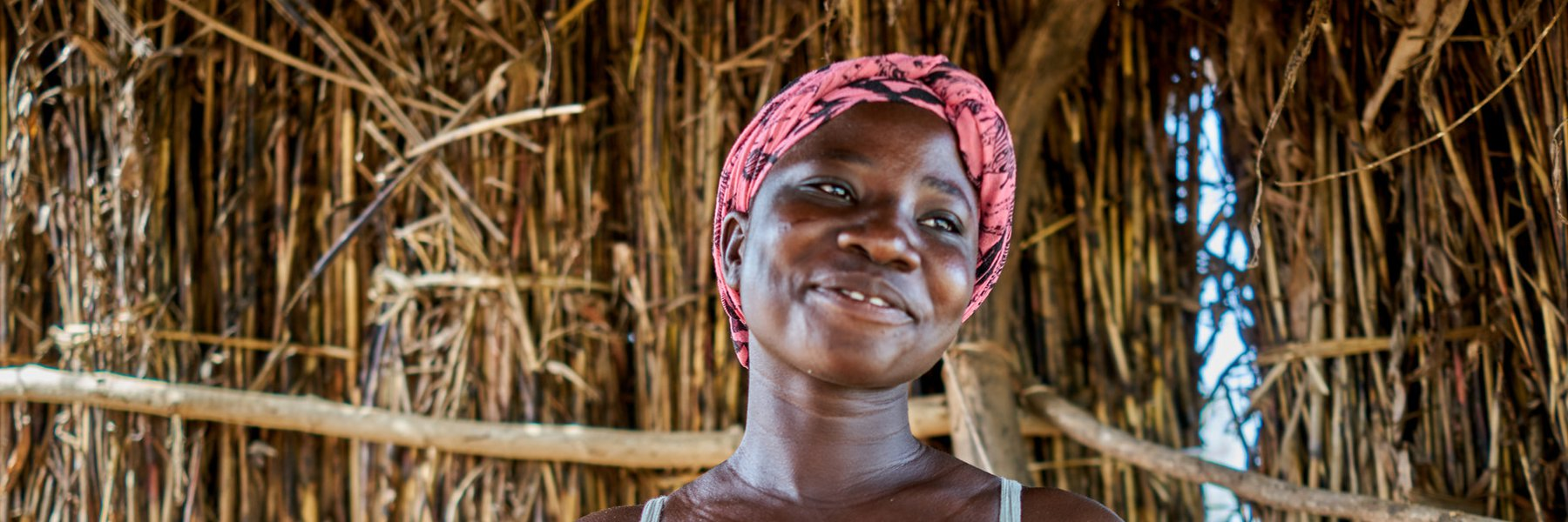 Lucy holding phone, Ghana
