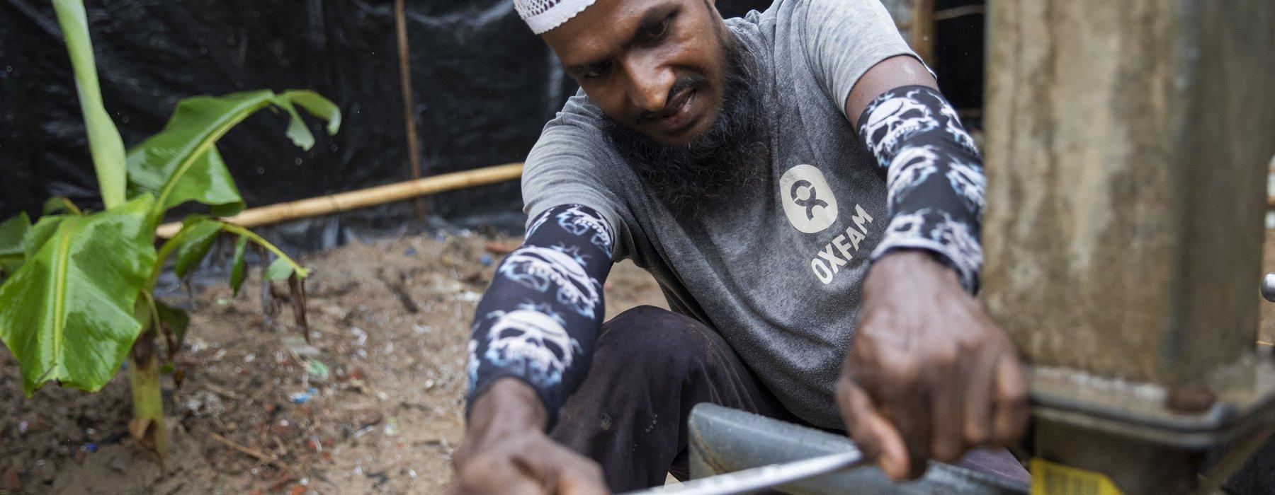 Cyclone Bulbul Preparations - Mechanic fixing hand pump