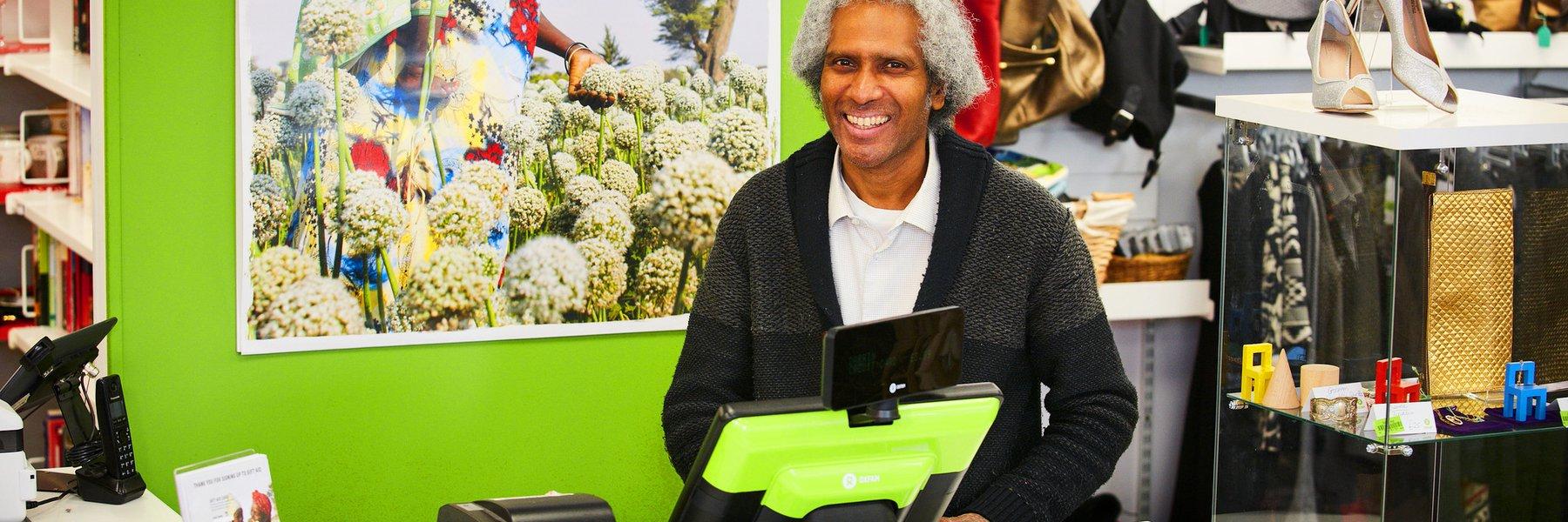 Regular volunteer, Johnson, at Bethnal Green Oxfam shop