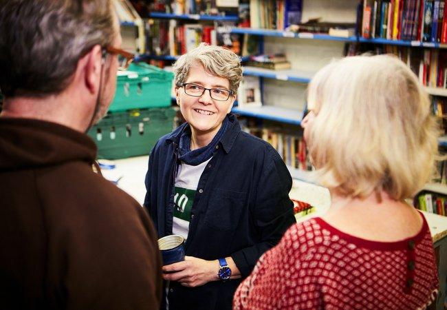 Regular volunteers Charlie, Linda and Helen chatting at Marylebone shop
