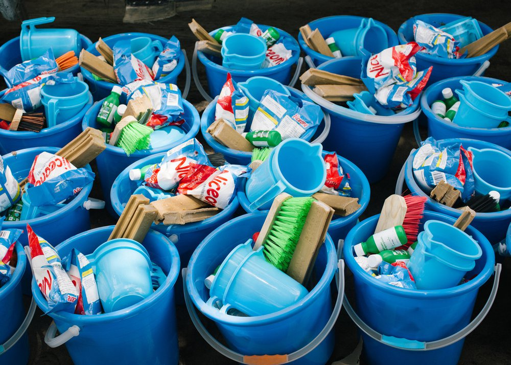 Hygiene kits ready for distribution in Mozambique. Each kit consists of a bucket filled with useful items such as a water jug, soap, brush and washing powder.