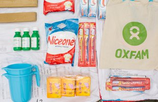 Toothbrushes bars of soap and other items for staying clean and healthy are laid out