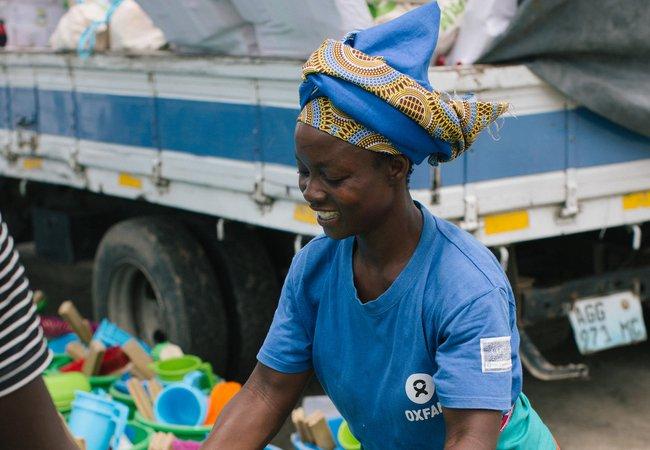 Elsa, 39 distributing Oxfam hygiene kits