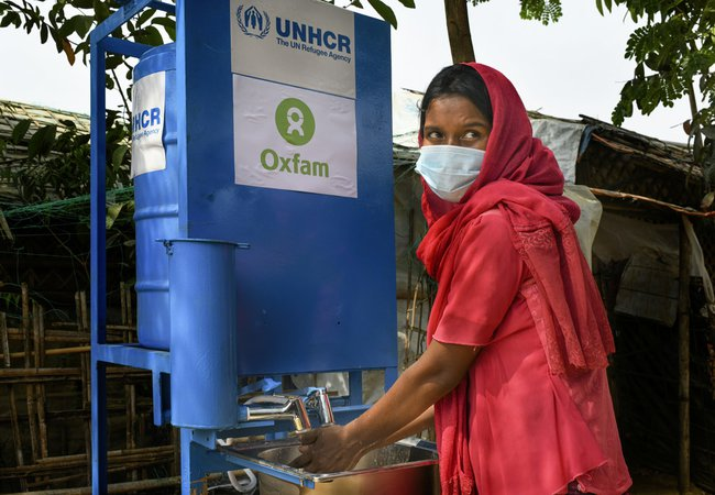Nur is washing her hands in Cox's Bazar refugee camp, Bangladesh
