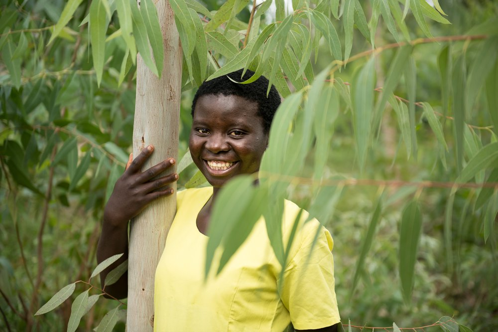 Jessy hugging a tree her father planted with her
