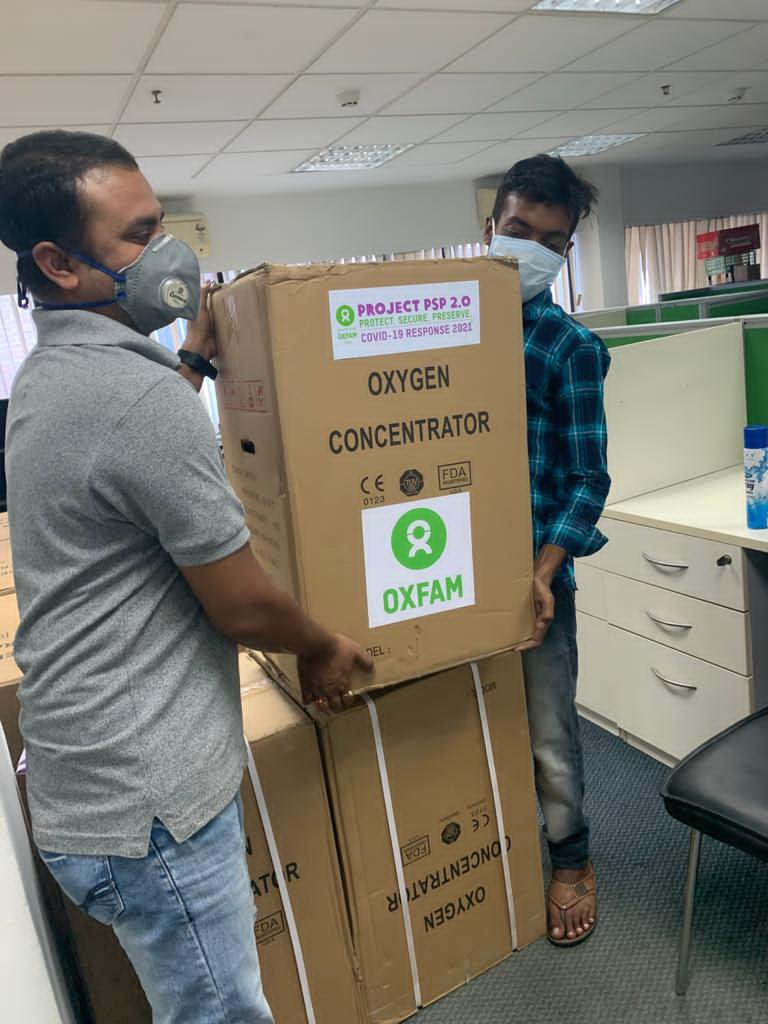 Oxygen supplies in boxes with Oxfam labels on them