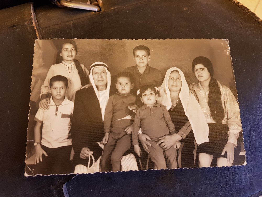 A sepia photograph of Dr. Khalid's family