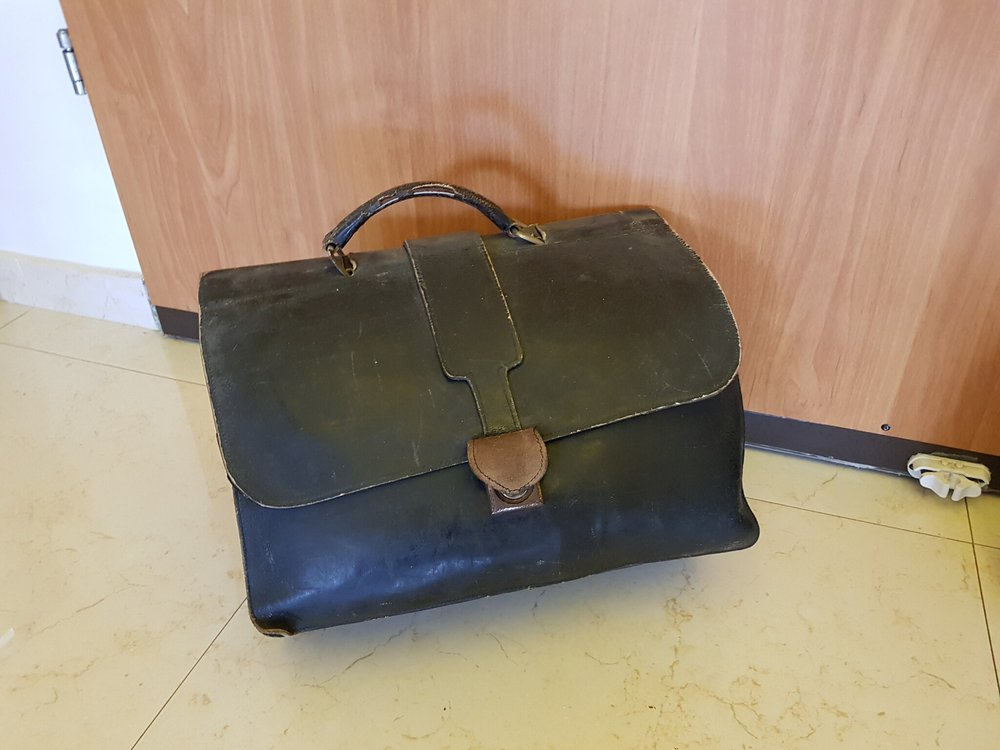 Dr. Khalid's leather suitcase inherited in 1956 from his grandfather