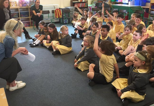 An Oxfam speakers talking to school children