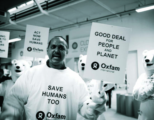 A black and white image of a climate change protestor at a protest