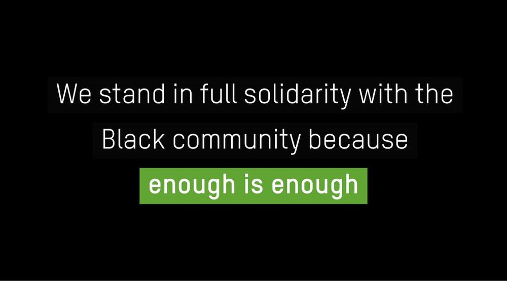 The words 'we stand in full solidarity with the Black community because enough is enough' on a black background.