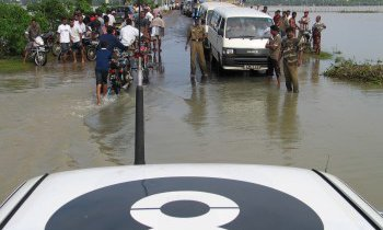 An Oxfam emergency evaluation team making their way across the flooded roads south of Batticaloa in Sri Lanka, one of the areas worst hit by the 2004 Tsunami