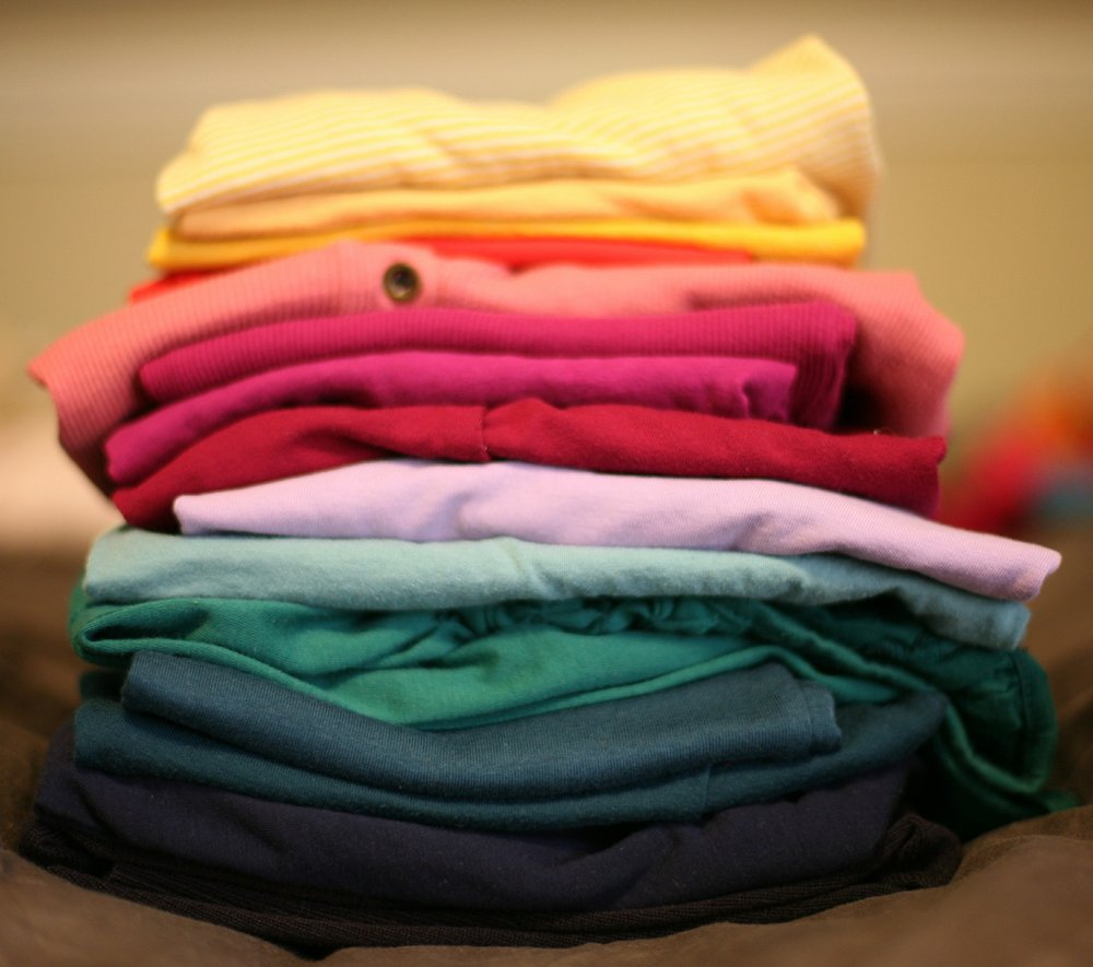 A colourful stack of folded laundry
