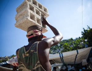 Carrying concrete blocks up hill in Carrefour Feuilles, Port au Prince, Haiti