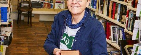 Shop volunteer Helen organising books at the Marylebone Oxfam shop
