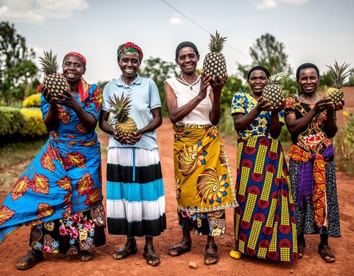 Pineapple growers - supported by Oxfam - outside the Cooperative centre in Eastern Rwanda.