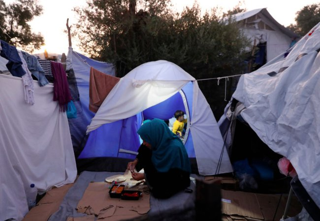 A family in a tent in Moria refugee camp in Greece