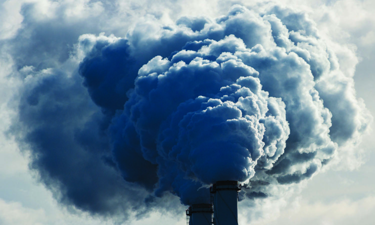 Smoke coming out of a coal plant chimney