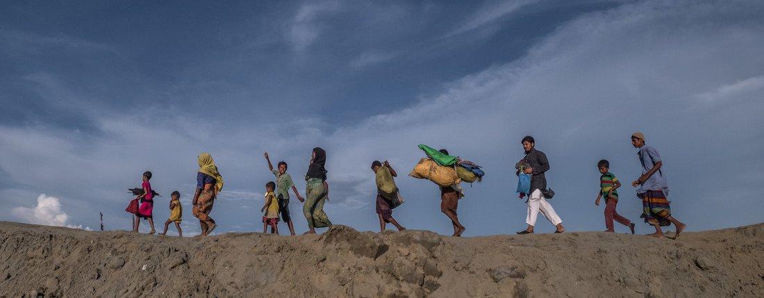 Rohingya refugees fleeing Myanmar for Bangladesh.
