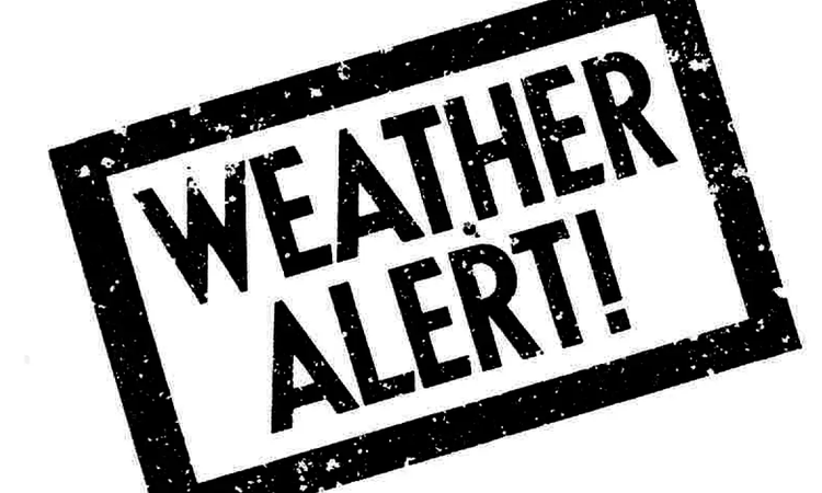 Text with a rubber stam effect that says 'weather alert'
