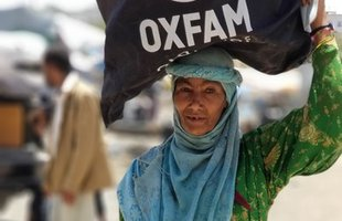 A woman with hygiene supplies distributed by Oxfam in Yemen
