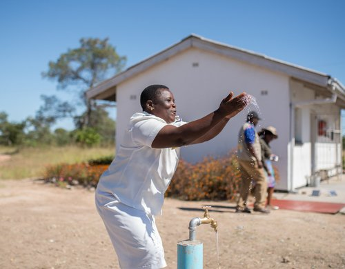 Nurse Tsitsi celebrates having running water for the first time at Somerton clinic in Masvingo District, Zimbabwe.